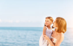 Happy family at beach. mother hugging child daughter Stock Photography