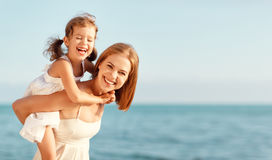 Happy family at beach. mother hugging child daughter Stock Photo