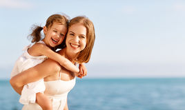 Happy family at beach. mother hugging child daughter Stock Image