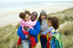 Happy family on beach path Stock Image