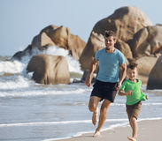 Happy family on beach playing, father with son Stock Photography