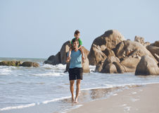 Happy family on beach playing, father with son Royalty Free Stock Photos