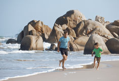 Happy family on beach playing, father with son Stock Photo