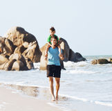 Happy family on beach playing, father with son walking sea coast Royalty Free Stock Image