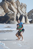 Happy family on beach playing, father with son Stock Photos