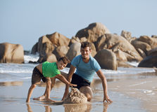 Happy family on beach playing, father with son Royalty Free Stock Photo