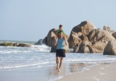 Happy family on beach playing, father with son Stock Images