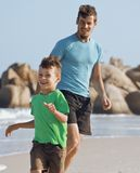 Happy family on beach playing, father with son Royalty Free Stock Image
