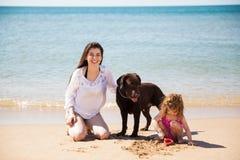 Happy family at the beach Royalty Free Stock Photography