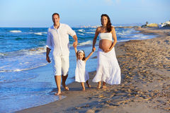 Happy family on the beach sand walking Stock Photography