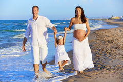 Happy family on the beach sand walking Royalty Free Stock Photo