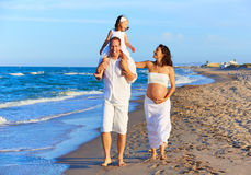 Happy family on the beach sand walking Royalty Free Stock Images