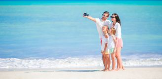 Panorama of happy beautiful family on the beach royalty free stock photography