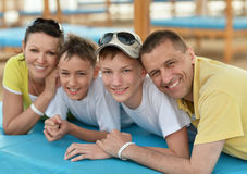 Happy family at beach on sunbed. Portrait of a happy family at beach on sunbed  in summer Stock Photos