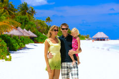 Happy family on the beach Stock Photography