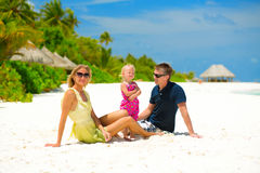 Happy family on the beach Stock Images