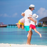 Happy family beach vacation in tropical island Stock Photography