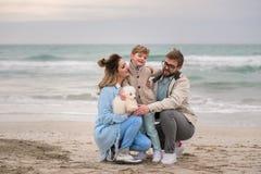 Happy family on a beach. royalty free stock photography