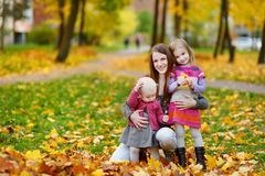 Happy family on beautiful autumn day Royalty Free Stock Photo