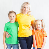 Happy family with beautiful mother and her children Stock Photos