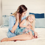 Happy Family. Beautiful Woman and Child Girl Hugging Stock Photography