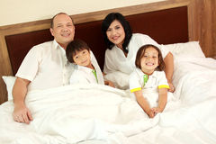 Happy family in the bed Stock Photography