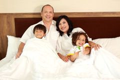 Happy family in the bed Stock Images
