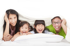 Happy   family on the bed Stock Photography