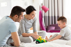 Happy family in bed at home or hotel room Royalty Free Stock Photo