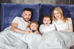 Happy family in bed Royalty Free Stock Images