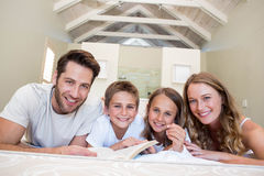 Happy family on the bed reading book Stock Photos