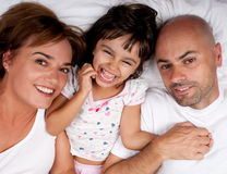 Happy family in bed on a sunday morning stock photos