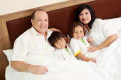 Happy family in the bedroom Stock Photos