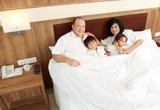 Happy family in the bedroom Royalty Free Stock Photo
