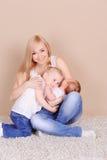Happy family on beige Stock Image
