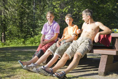 Happy family on bench Royalty Free Stock Images