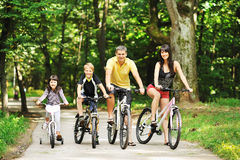 Happy family on a bicycles in the countryside Stock Image