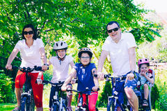 Happy family on bicycles in the park Stock Image