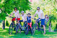 Happy family on bicycles in the park Royalty Free Stock Image