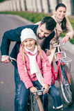 Happy family with bicycles Stock Images