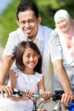 Happy family with bikes Stock Image