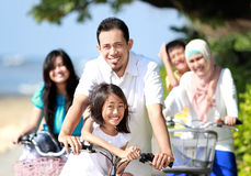Happy family with bikes Stock Photography