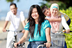 Happy family with bikes Stock Images