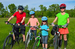 Happy family on bikes Royalty Free Stock Image