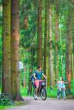 Happy family biking outdoors at the park Stock Images