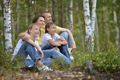 Happy family in a birch forest Stock Photos