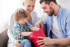 Happy family with birthday gift at home Royalty Free Stock Photos