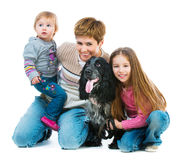 Happy family with black cocker spaniel. Isolated on white background royalty free stock photos