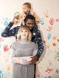 Happy family: black father, mom and baby boy. Use it for a child, parenting or love concept stock photo