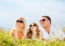 Happy family with blue sky and green grass Royalty Free Stock Photography